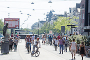 Nederland, Den Haag, 08-06-2014<br /> In Den Haag fietsen mensen door de Grote Marktstraat, een belangrijke winkelstraat. Alleen fietsers en voetgangers mogen hier komen. <br /> <br /> In The Hague people cycle at the Grote Markstraat. Only bicycles and pedestrians are allowed in this street.