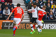 Derby County midfielder Ikechi Anya under pressure from Huddersfield defender Martin Cranie during the EFL Sky Bet Championship match between Derby County and Huddersfield Town at the Pride Park, Derby, England on 17 April 2017. Photo by Aaron  Lupton.