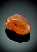 Cutout of a Carnelian (also spelled cornelian) gemstone on black background