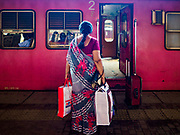 07 OCTOBER 2017 - COLOMBO, SRI LANKA: A woman waits to board a 2nd class train at the Fort Station in Colombo. The Fort Station is Colombo's main train station and serves as the hub of Sri Lanka's train system. The station opened in 1917 and is modeled after Manchester Victoria Station.    PHOTO BY JACK KURTZ