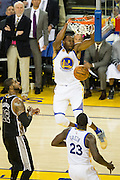 Golden State Warriors forward Andre Iguodala (9) slams the ball into the basket against the San Antonio Spurs at Oracle Arena in Oakland, Calif., on October 25, 2016. (Stan Olszewski/Special to S.F. Examiner)