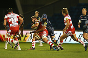 B Curry hols E Slater during the Aviva Premiership match between Sale Sharks and Gloucester Rugby at the AJ Bell Stadium, Eccles, United Kingdom on 29 September 2017. Photo by George Franks.