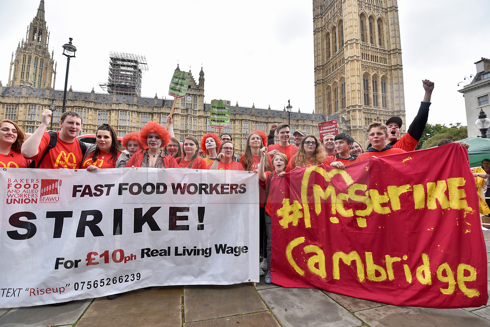 © Licensed to London News Pictures. 04/09/2017. London, UK. McDonald's staff and members of the Bakers Food and Allied Workers Union (BFAWU) attend a rally outside the Houses of Parliament in solidarity with McDonald's staff in Cambridge and Crayford who have gone on strike demanding an end to zero hours contracts and a minimum wage of GBP10 per hour.   Photo credit : Stephen Chung/LNP