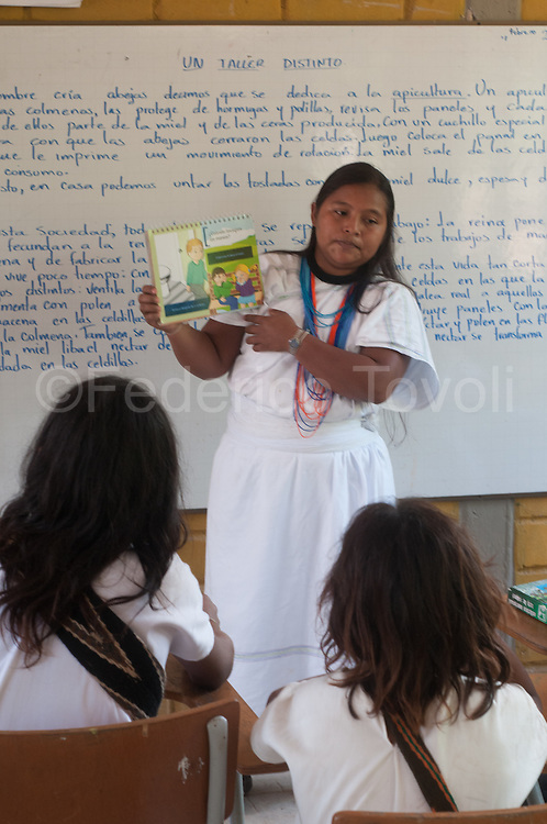 The Arhuaco village of  Bunquimaque on the coastal slope of the Sierra Nevada de Santa Marta, has been  virtually built around a primary and secondary school, where they work Arhuaco and not  Arhuaco teachers