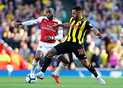 Watford's Andre Gray and Arsenal's Alexandre Lacazette battle for possession
