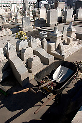 25 Oct,  2005.New Orleans, Louisiana. Hurricane Katrina aftermath.<br /> Flooded but not looted. 'City of the Dead.' The shrine at St. Roch's cemetery where people claim to have been cured miraculously by praying to Saint Roch. Once cured people have left their shoes, braces, calipers, crutches, replica body parts and casts of their anatomy allegedly cured by a visit to the shrine. Gothic style Chapel and Campo Santo cemetery built in 1874.<br /> Photo; &copy;Charlie Varley/varleypix.com