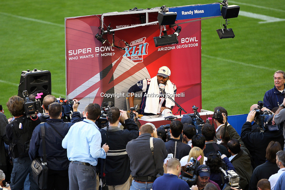 GLENDALE, AZ - JANUARY 29: Wide receiver Randy Moss #81 of the New England Patriots speaks to the media at the Patriots Super Bowl XLII Media Day at University of Phoenix Stadium on January 29, 2008 in Glendale, Arizona.©Paul Anthony Spinelli *** Local Caption *** Randy Moss