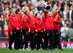 LIVERPOOL, ENGLAND - Saturday, October 5, 2013: Liverpool Ladies with the Women's Super League trophy as the team parade around at Anfield. (Pic by David Rawcliffe/Propaganda)