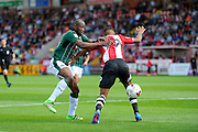 Paul-Arnold Garita (26) of Plymouth Argyle battles for possession with Luke Croll (29) of Exeter City during the EFL Sky Bet League 2 match between Exeter City and Plymouth Argyle at St James' Park, Exeter, England on 17 September 2016. Photo by Graham Hunt.