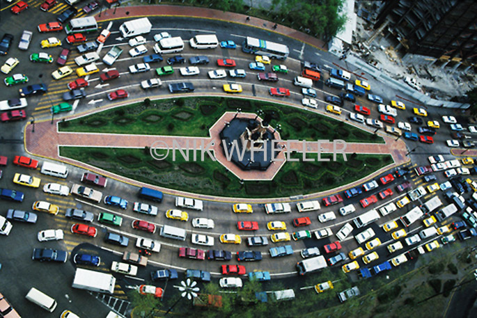Automobiles in massive traffic jam at traffic circle in downtown Mexico City