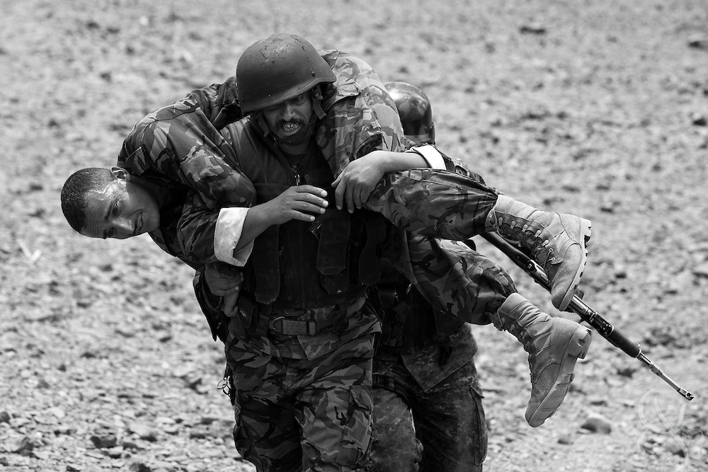 Members of the Yemen Special Forces Counter-Terrorism squad practice the evacuation of a wounded team member during live-fire drills at a training range on the outskirts of Sana'a, Yemen April 14, 2010. Yemen continues efforts to improve the quality of its' armed forces as it faces a Houthi rebel movement in the North, a  separatist movement in its Southern territory, and Al Qaeda terrorist activity.