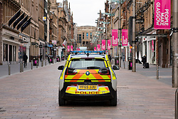 Glasgow, Scotland, UK. 1 April, 2020. Effects of Coronavirus lockdown on streets of Glasgow, Scotland. Electric police car patrols  deserted Buchanan Street. Iain Masterton/Alamy Live News