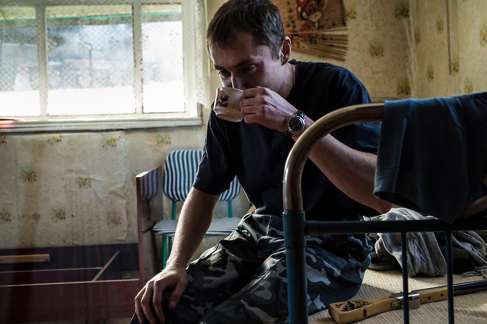 Vadim Kovalenko drinks tea at his dacha on Sunday, October 27, 2013 in Baikalsk, Russia.