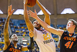 Jan 9, 2016; Morgantown, WV, USA; West Virginia Mountaineers forward Esa Ahmad (23) and Oklahoma State Cowboys forward Mitchell Solomon (41) jump for a rebound during the first half at the WVU Coliseum. Mandatory Credit: Ben Queen-USA TODAY Sports