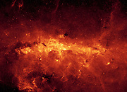 Centre of the Milky Way galaxy viewed by the Spitzer Space Telescope. Infrared image of the galactic centre and dusty clouds, lit up by young massive stars.  Credit NASA. Science Astronomy  Space