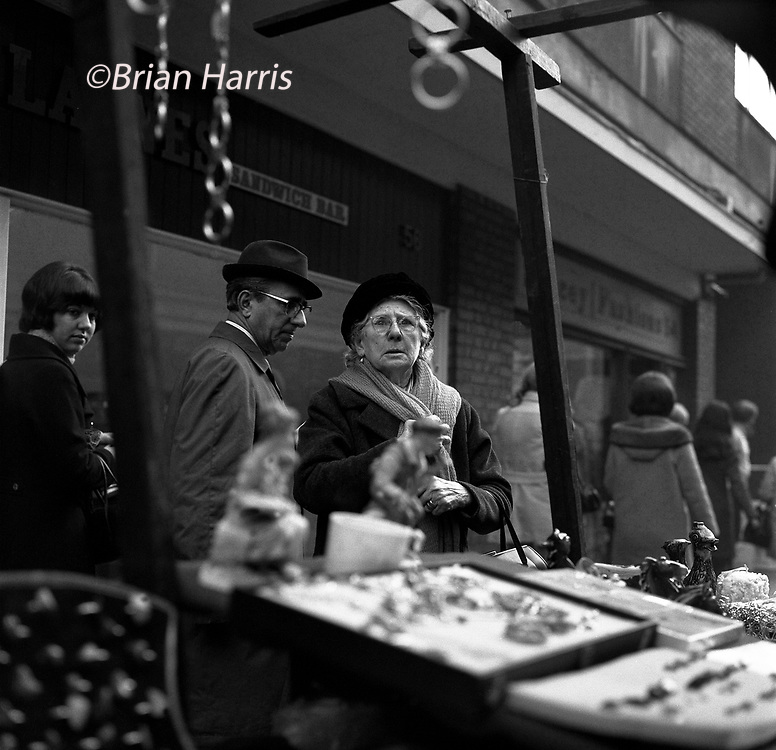 Leather Lane Street Market, London, England. 1970.<br /> Faces of market traders and customers in the popular Leather Lane Market near Hatton Garden in the Holborn area of London in 1970. The market attracted city types and local people who lived in the protected housing nearby, a real social mix. I made these images during my lunch hour when I was a messenger boy at Fox Photos a Press Agency in nearby Farringdon Road.