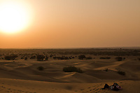 romantic couple looking at the sunset at khuri dunes in thar desert near jaisalmer in rajasthan state in india