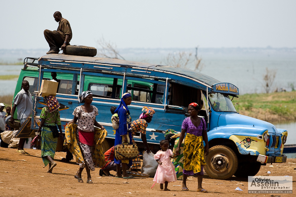 Local transportation awaits passengers at a ferry terminal on the shore of Lake Volta in Makango, northern Ghana on Thursday March 26, 2009.