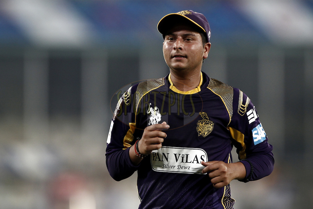 Kuldeep Singh Yadav of the Kolkata Knight Riders  during match 7 of the Oppo Champions League Twenty20 between the Kolkata Knight Riders and the Lahore Lions held at the Rajiv Gandhi Cricket Stadium, Hyderabad, India on the 21st September 2014<br /> <br /> Photo by:  Deepak Malik / Sportzpics/ CLT20<br /> <br /> <br /> Image use is subject to the terms and conditions as laid out by the BCCI/ CLT20.  The terms and conditions can be downloaded here:<br /> <br /> http://sportzpics.photoshelter.com/gallery/CLT20-Image-Terms-and-Conditions-2014/G0000IfNJn535VPU/C0000QhhKadWcjYs