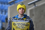 A young Oxford United fan show his colours during the EFL Sky Bet League 1 match between Oxford United and Shrewsbury Town at the Kassam Stadium, Oxford, England on 7 December 2019.