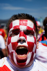 Croatian soccer fan with face painted in national colours at Football World Cup in Germany 2006