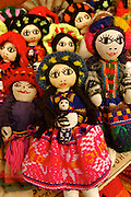 Typical doll  from the region of Cuzco, city  in the peruvian andes, the doll is holding a baby.