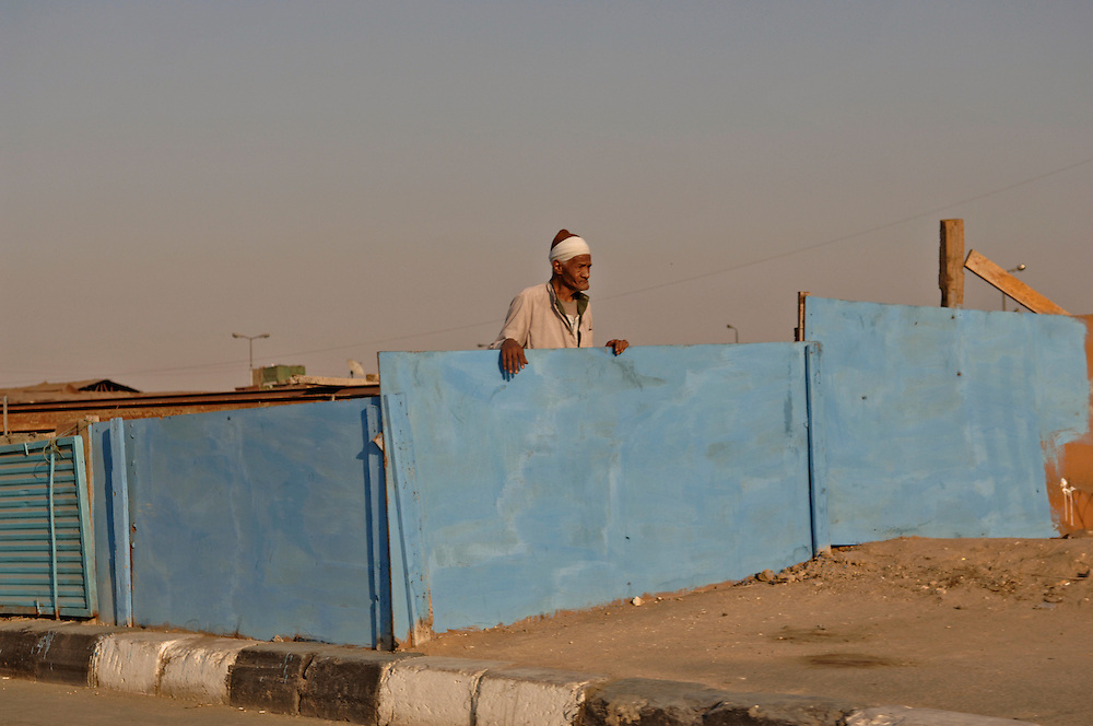 Man stands roadside. Cairo Egypt.