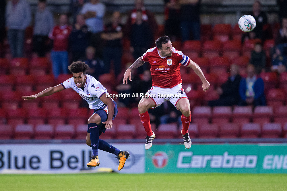 August 9th 2017, Gresty Road, Crewe, England; Carabao Cup First Round; Crewe Alexandra versus Bolton; Bolton Wanderers' Derik and Crewe Alexandra's Chris Dagnall jump for the ball