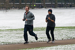 © Licensed to London News Pictures. 18/03/2018. London, UK. People running in Green Park as snow has fallen in Central London overnight. Photo credit: Ray Tang/LNP