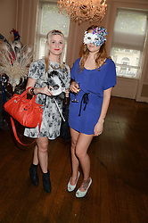 Left to right, ALICE FAYLE and FRANCESCA CALABRESE at the The Animal Ball – Masking Up Moment held at the Quintessentially Ballrooms, 29 Portland Place, London W1 on 10th June 2013.