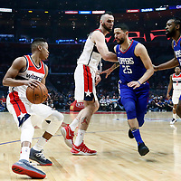 09 December 2017: LA Clippers guard Austin Rivers (25) and LA Clippers center DeAndre Jordan (6) defend on Washington Wizards guard Tim Frazier (8) during the LA Clippers 113-112 victory over the Washington Wizards, at the Staples Center, Los Angeles, California, USA.