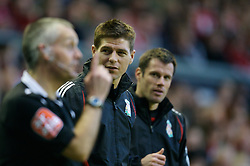 LIVERPOOL, ENGLAND - Saturday, January 26, 2008: Liverpool's super-star substitutes captain Steven Gerrard MBE and Jamie Carragher watch from the sidelines during the FA Cup 4th Round match against Havant and Waterlooville at Anfield. (Photo by David Rawcliffe/Propaganda)