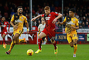 Matt Harrold of Crawley Town latches on to a ball over the top during the Sky Bet League 2 match between Crawley Town and Cambridge United at the Checkatrade.com Stadium, Crawley, England on 9 January 2016. Photo by Andy Walter.
