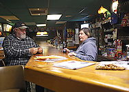 Elmer Monshower (from left) and Colleen McGinnis, both of Thomson, talk at Kyle's, a bar, in Thomson, Illinois on Monday November 16, 2009. (Stephen Mally for The New York Times)