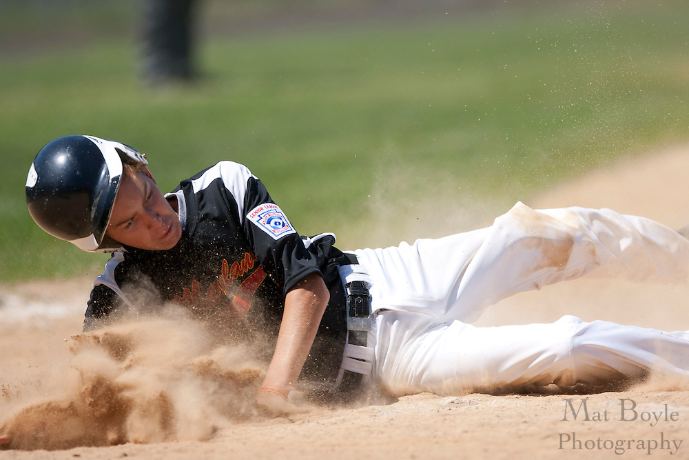 Maryland's Shaw Pritchett slides into home  to score a run for Maryland during the winner take all final of the Eastern Regional Senior League tournament between Pennsylvania and Maryland held in West Deptford on Thursday, August 11.