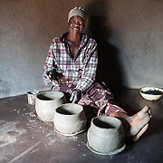 CAPTION: Suzan uses water to make clay pots for cooking at home. More borehole pumps mean more people will have easier access to water for household use, as well as for agriculture. LOCATION: Nhamo Village, Bikita District, Masvingo Province, Zimbabwe. INDIVIDUAL(S) PHOTOGRAPHED: Suzan Maisvogara.