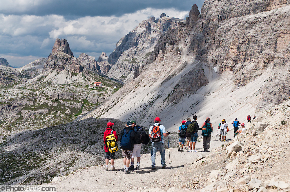 "Walk towards Rifugio Locatelli (Dreizinnenhütte) in the Sexten Dolomites Nature Reserve (Parco Naturale Dolomiti di Sesto, or Naturpark Sextner Dolomiten), Italy, Europe. Hike for spectacular views around Tre Cime di Lavaredo (Italian for ""Three Peaks of Lavaredo,"" also called Drei Zinnen or ""Three Merlons"" in German). Until 1919 the peaks formed part of the border between Italy and Austria. Now they lie on the border between the Italian provinces of South Tyrol and Belluno and still are a part of the linguistic boundary between German-speaking and Italian-speaking majorities. The Dolomites were declared a natural World Heritage Site (2009) by UNESCO."