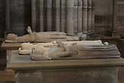Effigy of Jeanne de France, 1350-71, daughter of Philippe VI de Valois and Blanche de Navarre, made 1371 in marble by the atelier of Jean de Liege, and (middle) Blanche de Navarre, 1332-98, second wife of Philippe VI de Valois, made 1371 in marble by the atelier of Jean de Liege, and (back) Charles, 1270-1325, count of Valois, son of Philippe III and Isabelle of Aragon, originally from the Eglise des Jacobins in Paris, brought to Saint-Denis in 1817, made early 14th century in marble, in the Basilique Saint-Denis, Paris, France. The basilica is a large medieval 12th century Gothic abbey church and burial site of French kings from 10th - 18th centuries. Picture by Manuel Cohen
