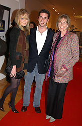 Left to right, LADY ELOISE ANSON, the HON.JAMES TOLLEMACHE and his mother LADY TOLLEMACHE at an exhibition of photographs by Jack Cardiff held at The Royal College of Art, Kensington Gore, London on 10th November 2004.<br />