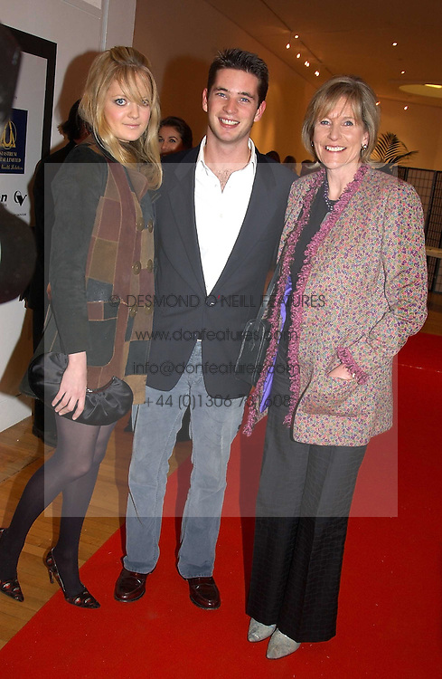 Left to right, LADY ELOISE ANSON, the HON.JAMES TOLLEMACHE and his mother LADY TOLLEMACHE at an exhibition of photographs by Jack Cardiff held at The Royal College of Art, Kensington Gore, London on 10th November 2004.<br /><br />NON EXCLUSIVE - WORLD RIGHTS