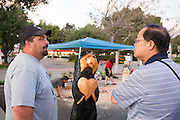 Ray Schulz shares stories and talks about his experiences carving wooden bears for Black Bear Diner over the past 15 years.  Schulz visited the Black Bear Diner in Milpitas, Calif. on July 11, 2012 to demonstrate his the carving process and to fund-raise for Milpitas High School.  Photo by Stan Olszewski/SOSKIphoto.