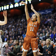 UNCASVILLE, CONNECTICUT- DECEMBER 4: Brooke McCarty #11 of the Texas Longhorns shoots while defended by Katie Lou Samuelson #33 of the Connecticut Huskies during the UConn Huskies Vs Texas Longhorns, NCAA Women's Basketball game in the Jimmy V Classic on December 4th, 2016 at the Mohegan Sun Arena, Uncasville, Connecticut. (Photo by Tim Clayton/Corbis via Getty Images)