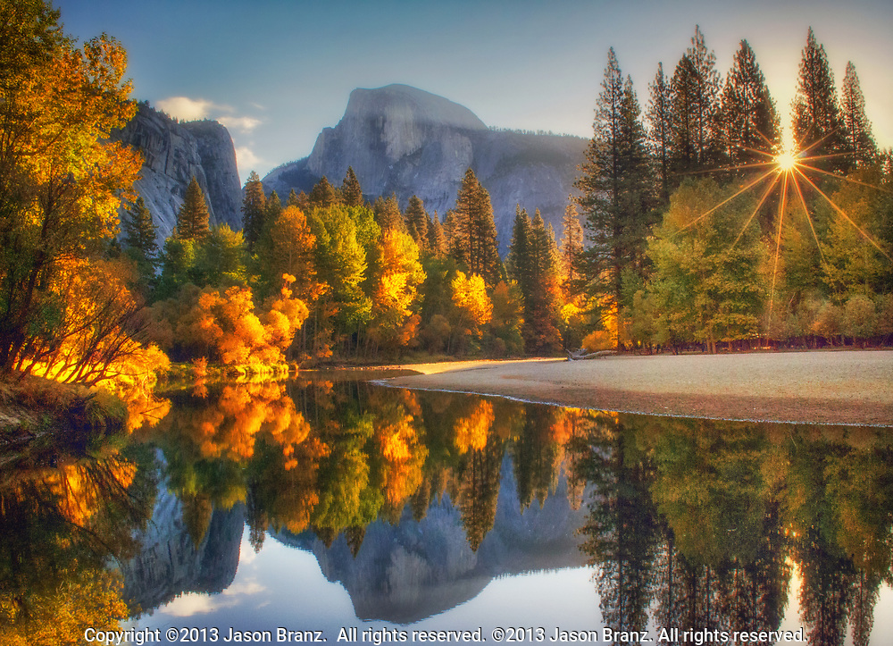 Autumn sunrise over Half Dome and the Merced River, Yosemite National Park, California.