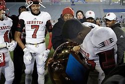 Star Running back Mike Waters of Imhotep Panthers is seen kissing the State Championship trophy. (photo by Bastiaan Slabbers)