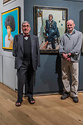 Born with no arms, Frank Letch MBE with his portrait by Vin Jelley, both pictured - The Royal Society of Portrait Painters Annual Exhibition at the Mall Galleries. It includes over 200 portraits by over 100 artists.
