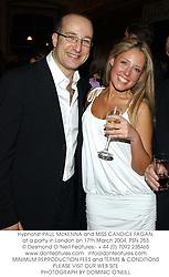 Hypnotist PAUL McKENNA and MISS CANDICE FAGAN, at a party in London on 17th March 2004.PSN 253