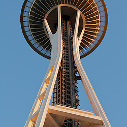 The space needle rises into the evening sky in  Seattle, Washington.