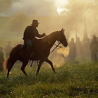 A Union officer on horseback gives instructions to a line of soldiers on the battlefield during a sunrise reenactment of Donelson's Attack, part of a weekend of events commemorating the 150th anniversary of the Battle of Perryville in Perryville, Ky. Saturday October 6, 2012.  Photo by David Stephenson