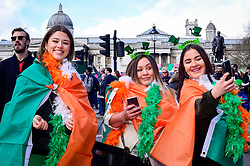 © Licensed to London News Pictures. 17/03/2019. LONDON, UK.  Revellers in colourful costumes watch the annual St. Patrick's Day parade and festival in the capital.  Photo credit: Stephen Chung/LNP