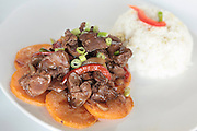 A plate of Chinese style stir fried beef served with rice